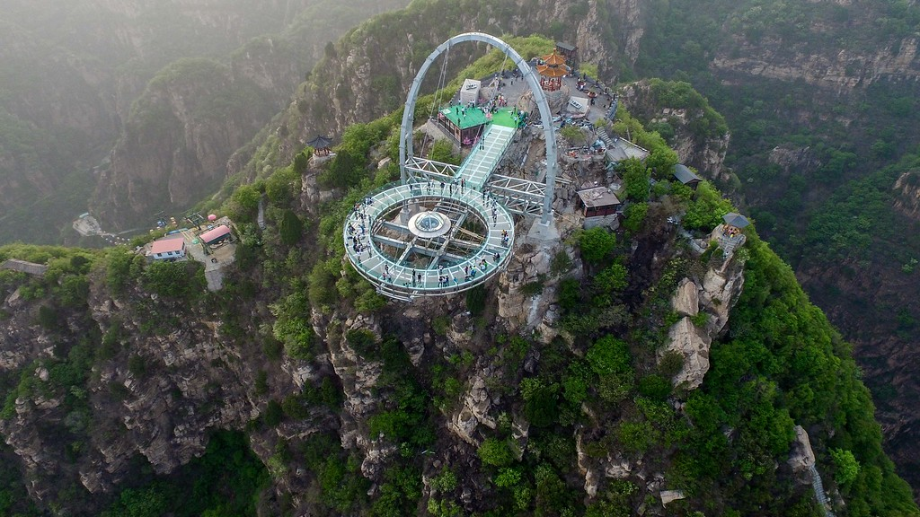 . This photo taken on April 30, 2016 shows a glass sightseeing platform in Shilinxia scenic spot in Pinggu District of Beijing.  The sightseeing platform, which hangs 32.8 meters out from the cliff, is claimed to be the largest glass sightseeing platform in the world. / AFP PHOTO / STR / /AFP/Getty Images