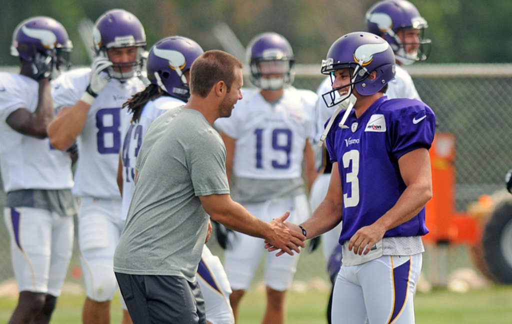 . Vikings kicker Blair Walsh is congratulated by a staff person after making a very long field goal on the last day of training camp.  (Pioneer Press: Chris Polydoroff)