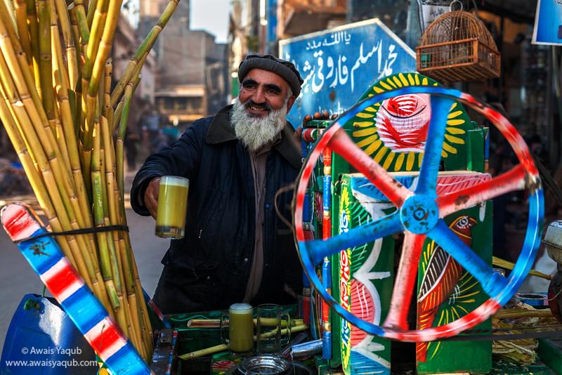 Generous old man sells sugar cane juice in streets of Peshawar.