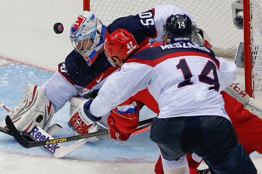 . Slovakia goaltender Jan Laco blockades a shot by Russia forward Alexander Radulov in the third period of a men\'s ice hockey game at the 2014 Winter Olympics, Sunday, Feb. 16, 2014, in Sochi, Russia. (AP Photo/Julio Cortez)