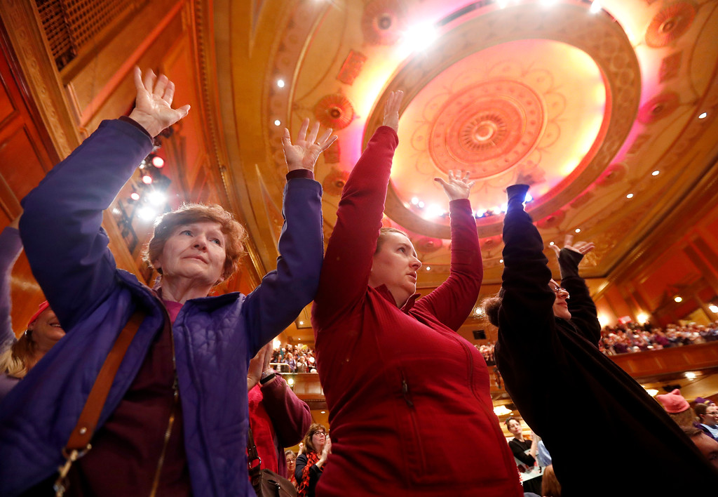 . Women react during a rally in support of the national Women\'s March on Washington during a gathering at Patriots Theater at the War Memorial, Saturday, Jan. 21, 2017, in Trenton, N.J. The march was held in in conjunction with with similar events taking place around the nation following the inauguration of President Donald Trump. (AP Photo/Julio Cortez)