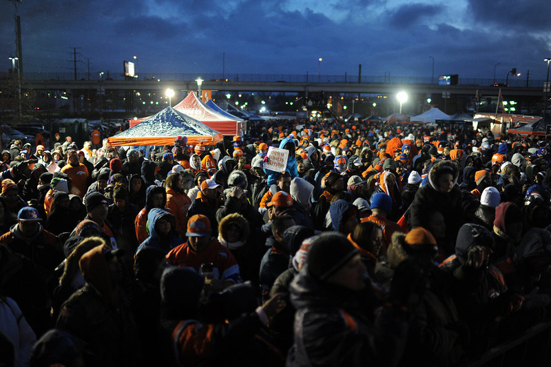 . Denver Broncos fans are in the United in Orange Pep Rally at Sports Authority Field at Mile High in Denver on Friday. Denver. CO, January 11, 2013.  Hyoung Chang, The Denver Post