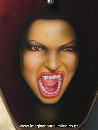 Vampire woman and flames bike