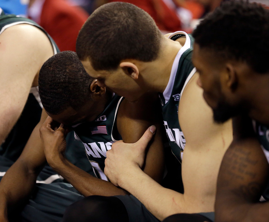 . Michigan State players react on the bench during the second half of the NCAA Final Four tournament college basketball semifinal game against Duke Saturday, April 4, 2015, in Indianapolis. Duke won 81-61. (AP Photo/Michael Conroy)