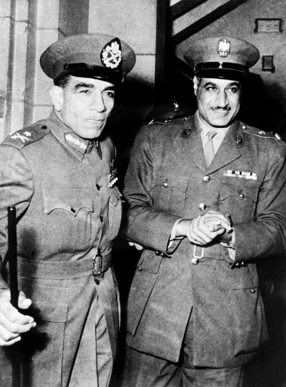 . General Mohamed Neguib (L) and Colonel Gamal Abdel Nasser leave the last Revolutionary meeting late 23 February 1954. AFP/Getty Images