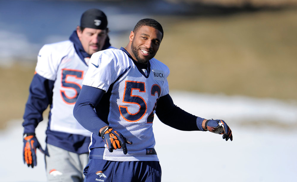. Denver Broncos outside linebacker Wesley Woodyard (52) stretches during practice Wednesday, January 2, 2013 at Dove Valley.  John Leyba, The Denver Post