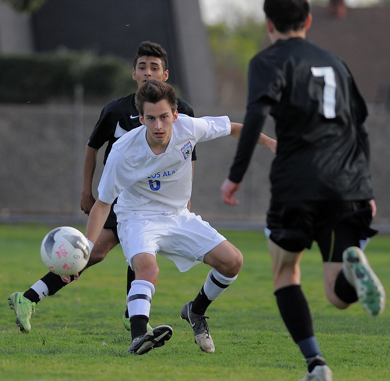 . 02-15-2012--(LANG Staff Photo by Sean Hiller)- Los Alamitos beat Buena 4-1 in the first round of the Division 1 boys soccer playoffs Friday at Laurel School in Los Alamitos. Los Alamitos\' Zach Way battles Buena.
