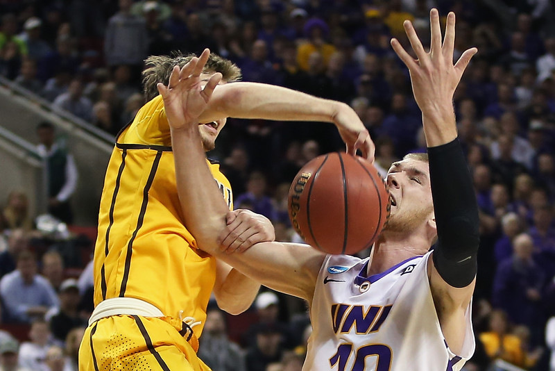 . Riley Grabau #2 of the Wyoming Cowboys blocks a shot by Seth Tuttle #10 of the Northern Iowa Panthers during the second round of the 2015 Men\'s NCAA Basketball Tournament at KeyArena on March 20, 2015 in Seattle, Washington.  (Photo by Otto Greule Jr/Getty Images)