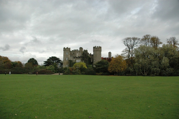 Green grass and Malahide Castle