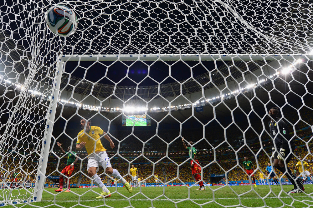 . Fred of Brazil turns to celebrate after scoring his team\'s third goal past Charles Itandje of Cameroon during the 2014 FIFA World Cup Brazil Group A match between Cameroon and Brazil at Estadio Nacional on June 23, 2014 in Brasilia, Brazil.  (Photo by Buda Mendes/Getty Images)