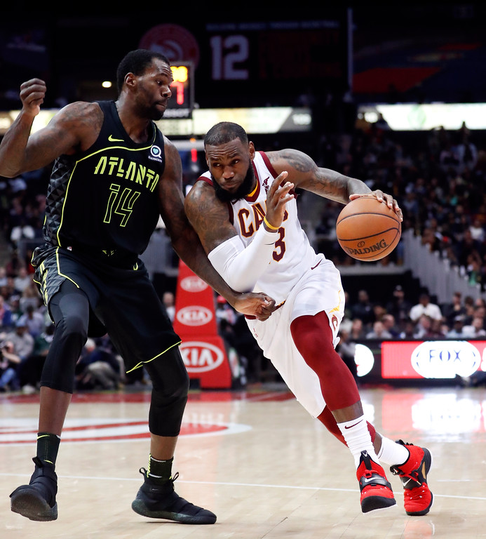 . Cleveland Cavaliers forward LeBron James (23) works against Atlanta Hawks center Dewayne Dedmon (14) in the second half of an NBA basketball game Friday, Feb. 9, 2018, in Atlanta. Cleveland won 123-107. (AP Photo/John Bazemore)