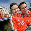 """The new """"Face of Armagh"""" Anthony Reavey from Newry is pictured with his daughter Naimh next to the billboard in which he appears alongside Armagh County players Francis Bellew and Paul McGrane. 06W34N2"""