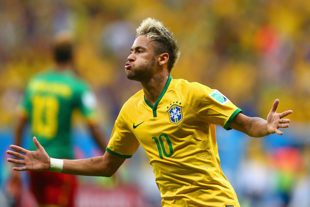 . Neymar of Brazil celebrates scoring his team\'s second goal and his second of the game during the 2014 FIFA World Cup Brazil Group A match between Cameroon and Brazil at Estadio Nacional on June 23, 2014 in Brasilia, Brazil.  (Photo by Clive Brunskill/Getty Images)