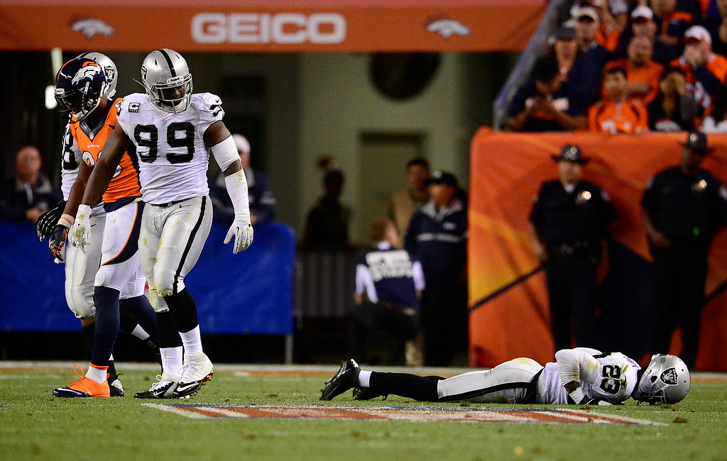 . DENVER, CO - SEPTEMBER 23: Oakland Raiders cornerback Tracy Porter (23) takes some extra time to get up in the third quarter. The Denver Broncos took on the Oakland Raiders at Sports Authority Field at Mile High in Denver on September 23, 2013. (Photo by AAron Ontiveroz/The Denver Post)