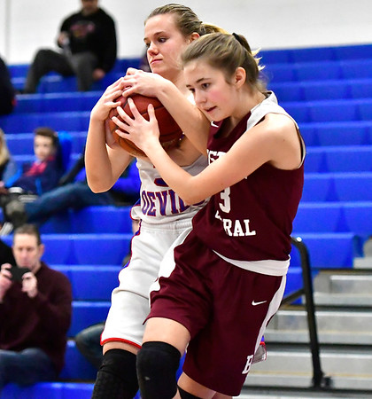 12/13/2018 Mike Orazzi | Staff Plainville High School's Caitlyn Barker (3) and Bristol Central's Ella Watson (23) during Thursday night's basketball game at PHS.