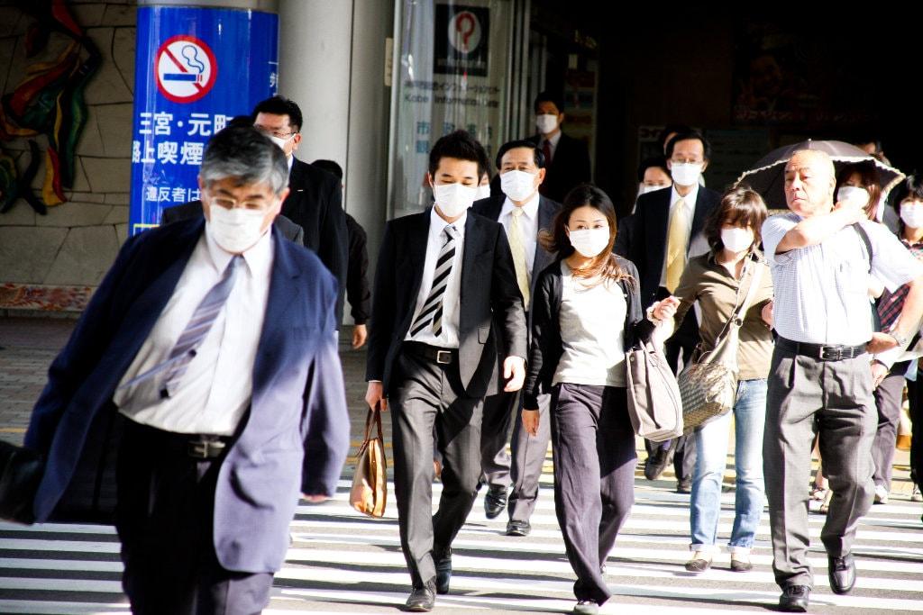 People wearing masks in Kobe. Editorial credit: Hinochika / Shutterstock.com