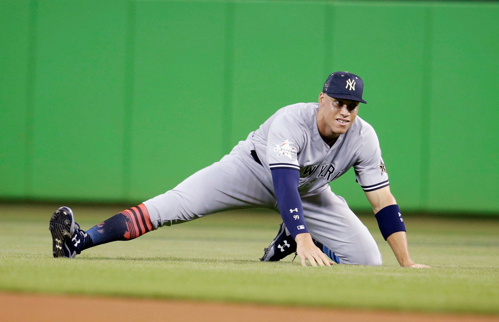 . American League\'s New York Yankees outfielder Aaron Judge (99) stretches before the start of the MLB baseball All-Star Game, Tuesday, July 11, 2017, in Miami. (AP Photo/Lynne Sladky)