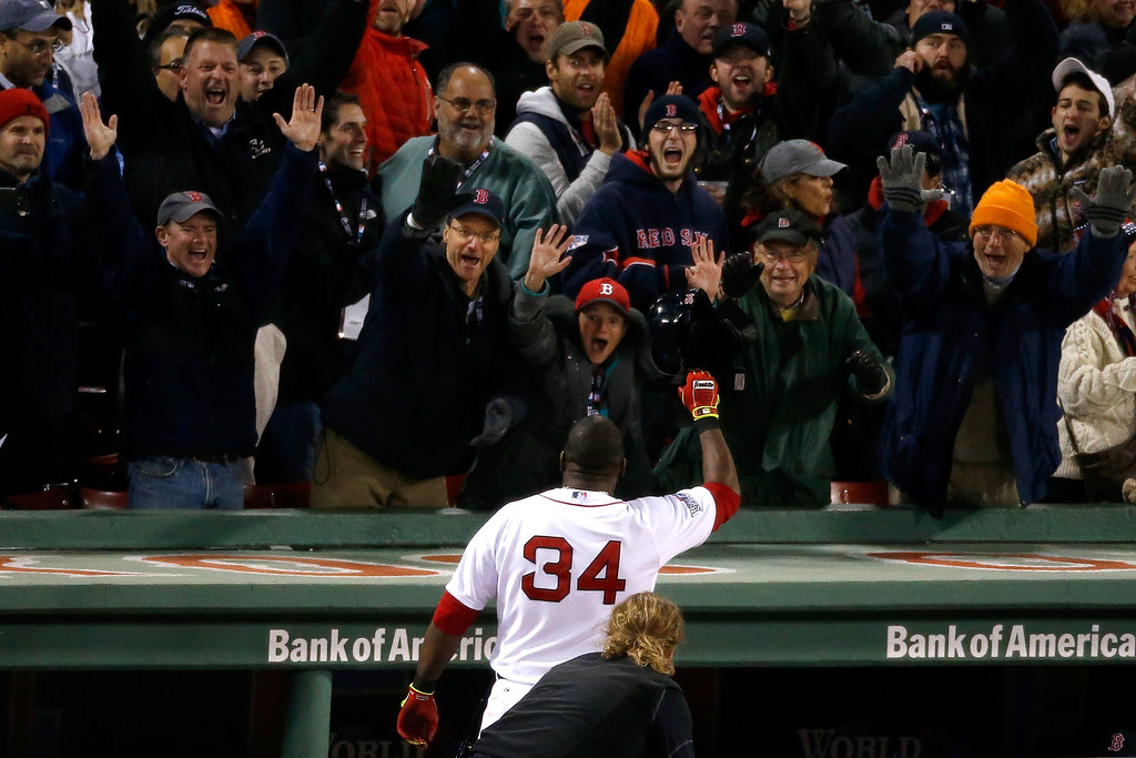 . BOSTON, MA - OCTOBER 24:  David Ortiz #34 of the Boston Red Sox celebrates after hitting a two run home run in the sixth inning against the St. Louis Cardinals during Game Two of the 2013 World Series at Fenway Park on October 24, 2013 in Boston, Massachusetts.  (Photo by Jim Rogash/Getty Images)