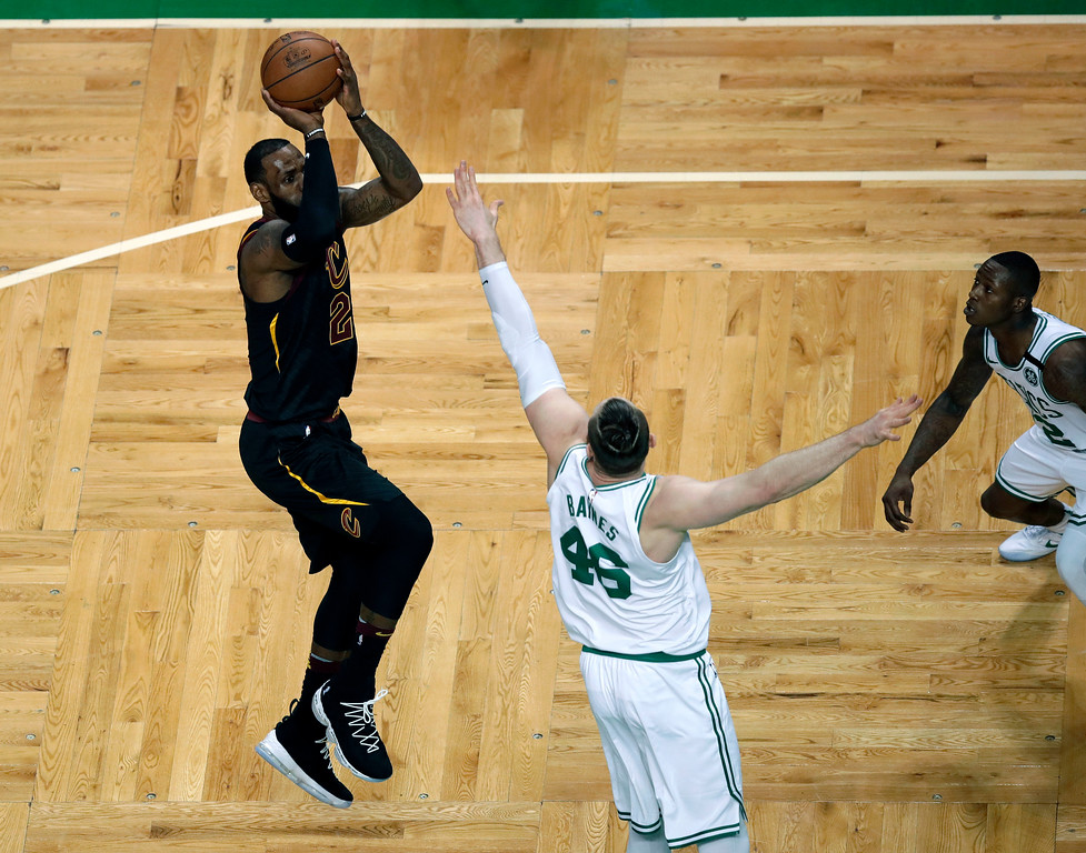 . Cleveland Cavaliers forward LeBron James, left, shoots over Boston Celtics center Aron Baynes (46) during the first half in Game 7 of the NBA basketball Eastern Conference finals, Sunday, May 27, 2018, in Boston. (AP Photo/Charles Krupa)