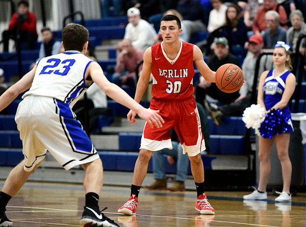 2/21/2019 Mike Orazzi | Staff Berlin High School's Gianni Fanelli (30) and Southington's Jake DelMonte (23) during the CCC Boys Basketball Tournament in Southington Thursday night.