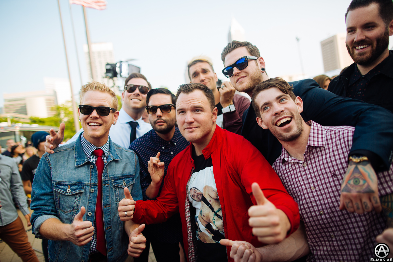 New Found Glory and A Day To Remember posting for a photo with another photographer