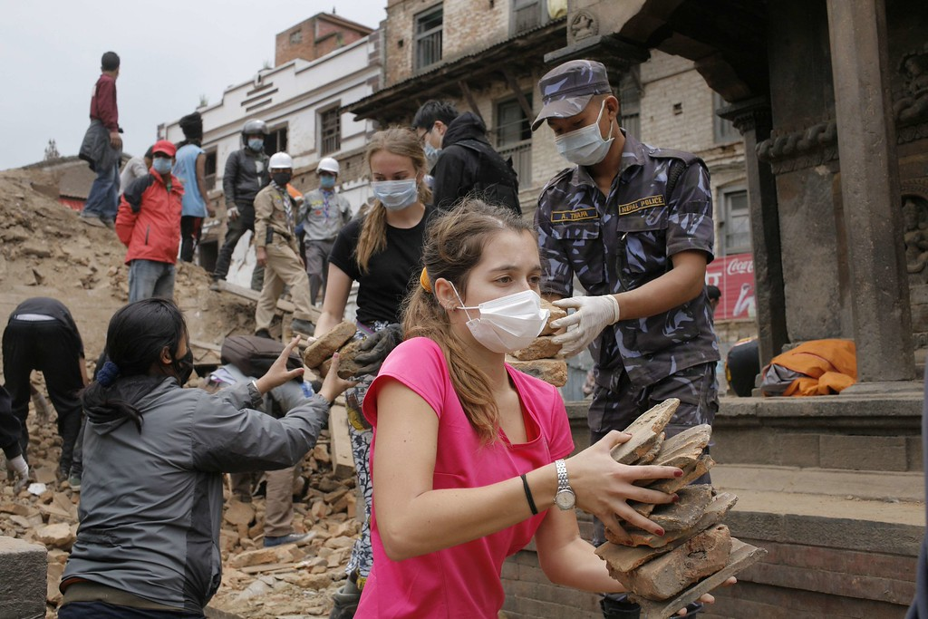 . In this hand out photograph taken and released by Caritas Internationalis on April 29, 2015, tourists clear rubble of temples at Durbar square, the UNESCO world heritage site damaged by the earthquake in Kathmandu.   A total of 5,057 people are so far known to have died in Nepal and around 100 more in neighboring India and China following the 7.8 magnitude earthquake on April 25. Around 8,000 were injured while the United Nations estimates that eight million people have been affected.  AFP PHOTO/ MATTHIEU ALEXANDRE/CARITAS INTERNATIONALIS/AFP/Getty Images