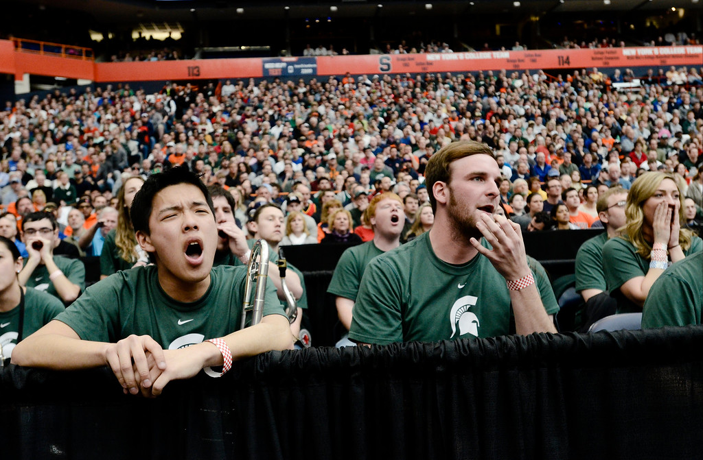 . Michigan State\'s band reacts during the first half of a regional final against Louisville in the NCAA men\'s college basketball tournament Sunday, March 29, 2015, in Syracuse, N.Y. (AP Photo/Heather Ainsworth)