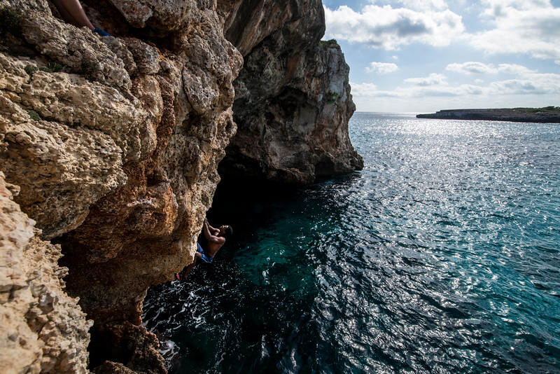 Area: Cala Barques, Spain / Metrosexual Area Climber: Lawrence Osefoh @godslafco Climb: Bisexual (DWS 5.10b/c//6b+/6c)  @godslafco starting on the lower access to Bisexual (DWS 5.10b/c//6b+/6c).