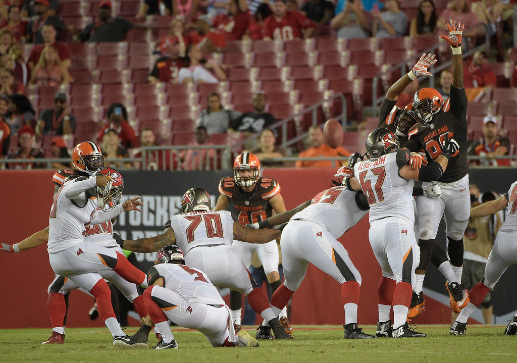 . Tampa Bay Buccaneers kicker Roberto Aguayo, left, kicks a field goal against the Cleveland Browns during the third quarter of an NFL preseason football game Friday, Aug. 26, 2016, in Tampa, Fla. (AP Photo/Phelan M. Ebenhack)