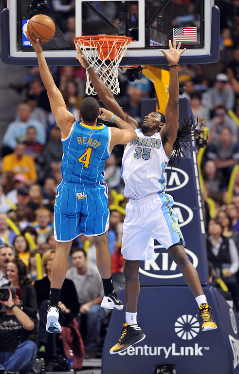 . DENVER, CO. - FEBRUARY 01: Xavier Henry of New Orleans Hornets #4 jumps for the basket over Kenneth Faried of Denver Nuggets #35 in the 2nd half of the game on February 1, 2013 at the Pepsi Center in Denver, Colorado. Denver won 113-98. (Photo By Hyoung Chang/The Denver Post)