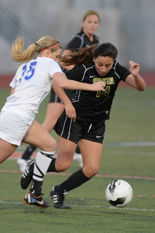 . Mira Costa\'s Alyssa Covarrubio drives the ball downfield as Westlake\'s McKenna Masters defends.  Westlake defeated Mira Costa 1-0 in the quarterfinal.  Photo by David Crane/Staff Photographer