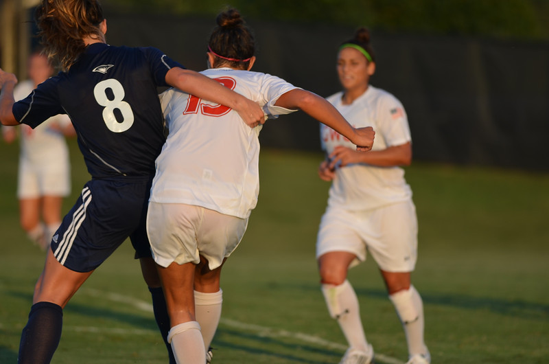 Tori James (13) fights to get the ball from the opposing side.
