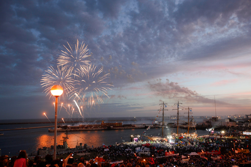 Description of . Fireworks explode as people demonstrate during a welcoming ceremony to celebrate the return of the ARA Libertad at Mar del Plata port, Argentina, Wednesday, Jan. 9, 2013. The Argentine naval ship detained for more than two months in Ghana because of a financial dispute returned home to a triumphant welcome.  Fernandez has called the Libertad a symbol of Argentina's sovereignty and has hailed its return as a victory for the country.  (AP Photo/Natacha Pisarenko)