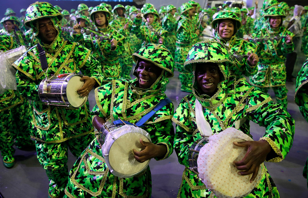 . Drummers from the Academicos do Tucuruvi samba school perform during a carnival parade in Sao Paulo, Brazil, Saturday, March 1, 2014. (AP Photo/Andre Penner)