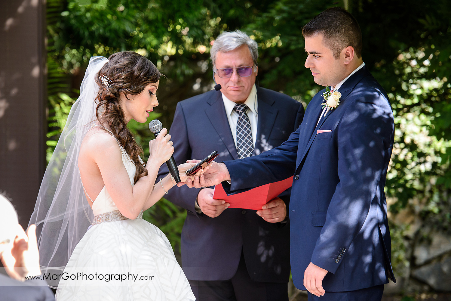 close-up of bride reading vows during wedding ceremony at Saratoga Foothill Club