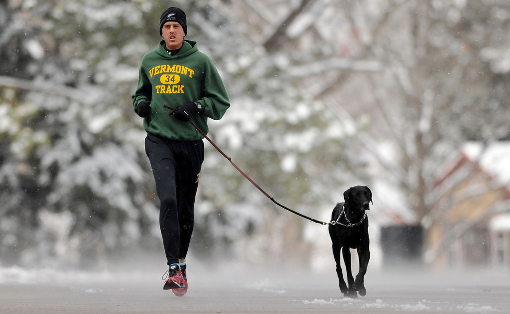 ". DENVER, CO. - APRIL 23 : Chris Healy of Denver is jogging with his dog ""Dasher\"" at Washington Park. Denver, Colorado. April 23, 2013. (Photo By Hyoung Chang/The Denver Post)"
