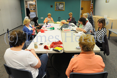 Members of the Yarn Crafters work on their projects