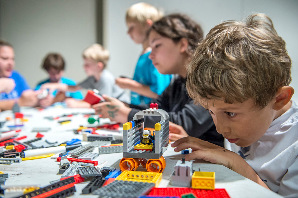 . Children participate in a past Lego summer camp at Great Lakes Science Center in Cleveland. This year, the attraction is celebrate the educational value of the toy line with its three-phase �Build It!� exhibition, which runs Feb. 4 through Sept. 4. For more information, visit greatscience.com. (Submitted)