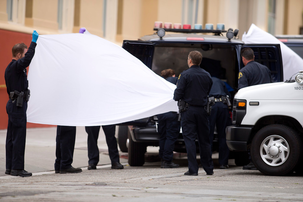 . Police hold up sheets to shield the sight of coroner\'s officials wheeling out one of the bodies at the scene of a balcony collapse at an apartment building on Kittredge Street in Berkeley, Calif., Tuesday, June 16, 2015. Six people were killed. (D. Ross Cameron/Bay Area News Group)