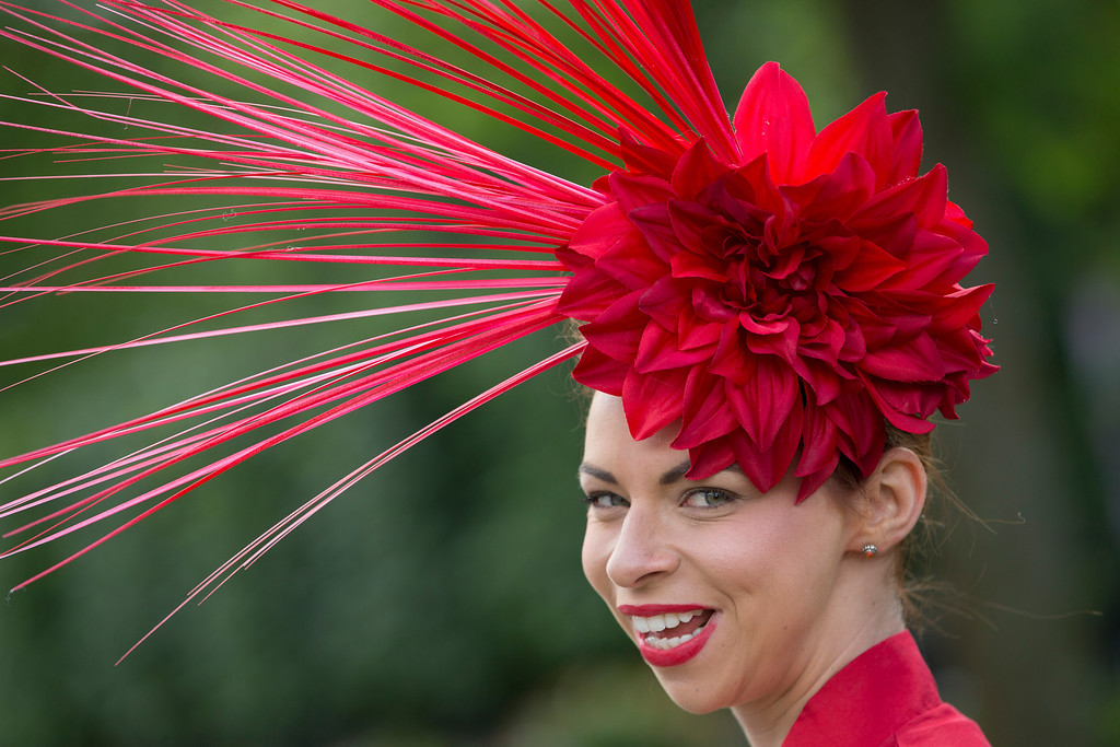 . Jaqui Jaynes wears an ornate hat on the second day of the Royal Ascot horse racing meeting at Ascot, England,  Wednesday, June, 18, 2014.  Royal Ascot the annual five day horse race meeting that Britain\'s Queen Elizabeth II attends every day of the event. (AP Photo/Alastair Grant)