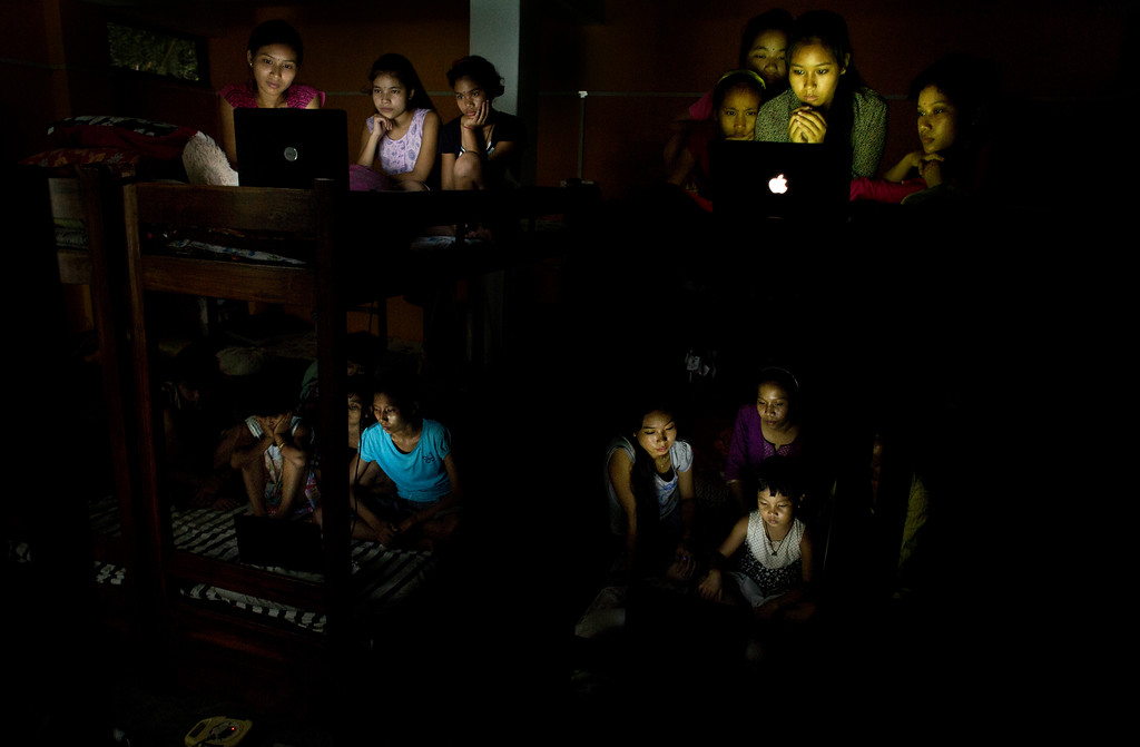 . Indian children at a school hostel watch on laptops the World Cup soccer final match between France and Croatia on the outskirts of Gauhati, India, Sunday, July 15, 2018. (AP Photo/Anupam Nath)