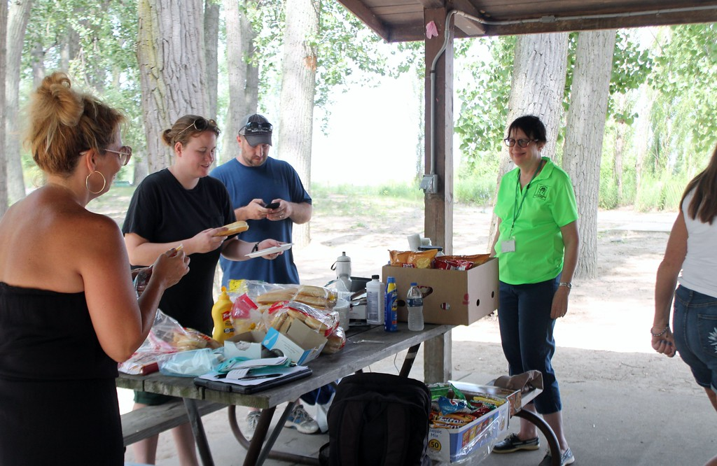 . Kristi Garabrandt � The News-Herald <br> Staff at Lake County Board of DD/Deepwood Recreation Service Program prepare a cook-out for the participants in the beach clean up project at Mentor Headlands Beach.