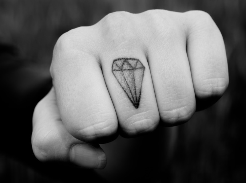 Finger with diamond tattoo