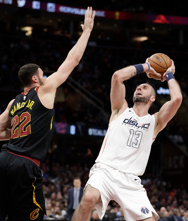 . Washington Wizards\' Marcin Gortat (13), from Poland, shoots over Cleveland Cavaliers\' Larry Nance Jr. (22) in the second half of an NBA basketball game, Thursday, April 5, 2018, in Cleveland. (AP Photo/Tony Dejak)