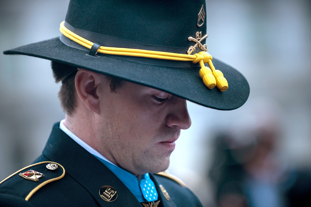 . Former US Army Staff Sargent Clinton Romesha pauses while speaking to the press outside the West Wing following his  Medal of Honor ceremony at the White House February 11, 2013 in Washington, DC. AFP PHOTO/Brendan SMIALOWSKI/AFP/Getty Images
