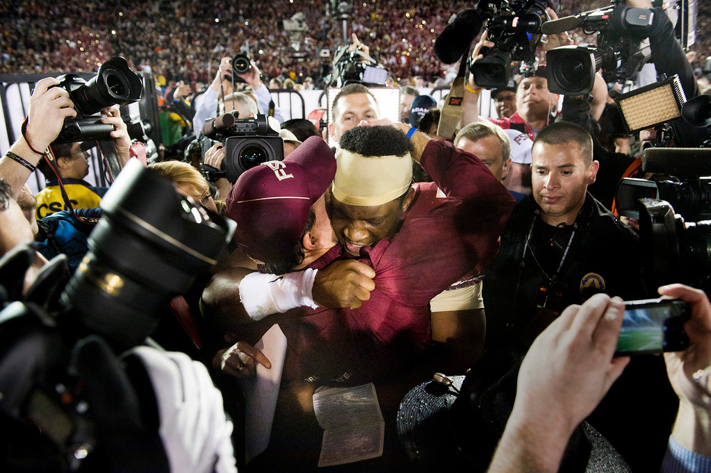 . Florida State head coach Jimbo Fisher celebrates with quarterback Jameis Winston (6) after winning the BCS National Championship game over Auburn at the Rose Bowl in Pasadena Calif. on Monday, Jan. 6, 2014. (Watchara Phomicinda/ Pasadena Star-News)