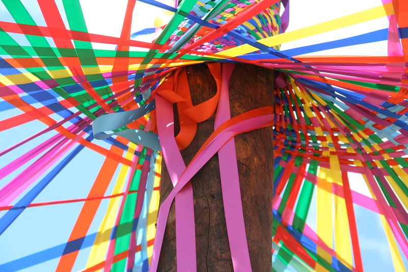 Ribbons winding tight around the pole