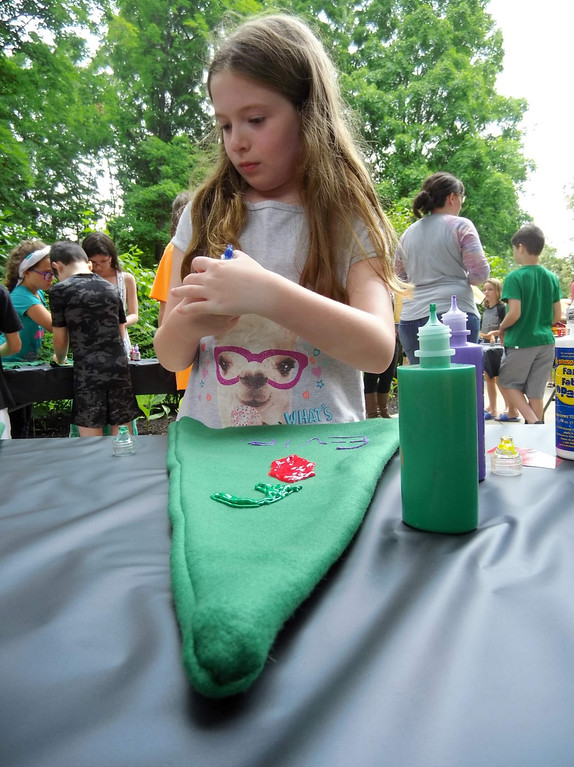 . Evie Smith paints a rose onto her Kokiri cap. (Courtesy Mentor Public Library)