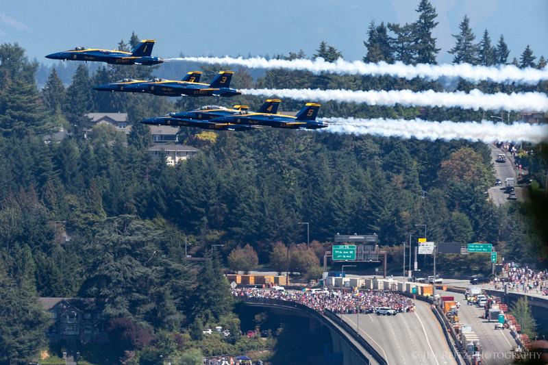 Blue Angels zoom across Seattle's I-90 bridge.