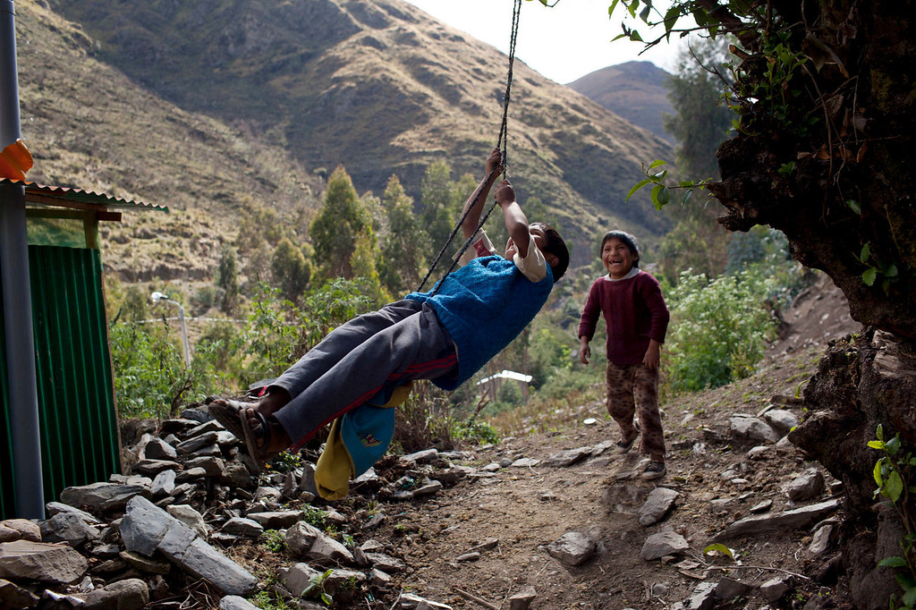 . A boy pushes another in a makeshift swing in Chaca, Peru, a remote region of Ayacucho state that endured some of the worst atrocities of Peru\'s 1980-2000 conflict. Chaca is among thousands of communities still waiting for reparations promised by the state eight years ago. It lacks running water and telephone service, medical attention is precarious and, during the four-month rainy season, it is inaccessible by vehicle as the dirt road link becomes mud. (AP Photo/Rodrigo Abd)